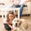 A happy family of three with dog — Stock Photo