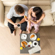 Carefree couple eating breakfast together — Stock Photo #26418093