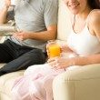 Resting couple having breakfast together in hotel — Stock Photo