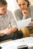 Troubled couple calculating finances — Stock Photo
