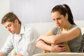 Unhappy couple sitting silently after argument — Stock Photo