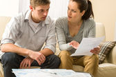 Worried couple talking about their expenses — Stock Photo