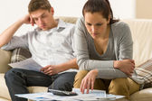 Annoyed couple calculating their finances — Stock Photo