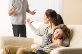 Arguing parents with upset little girl — Stock Photo