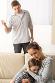 Mother protecting her daughter from angry father — Stock Photo