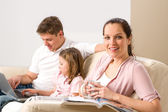Idyllic family portrait in their home — Stock Photo