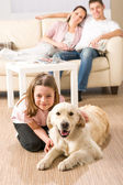 A happy family of three with dog — Stock Photo