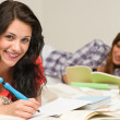 Smiling female students preparing for exam — Stock Photo