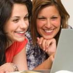 Joyful teens browsing on internet — Stock Photo