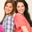 Happy sisters smiling and looking at camera — Stock Photo