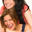 Foto Stock: Pretty teens laughing and smiling at camera