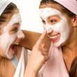 Playful teen wearing mask touches friend's nose — Zdjęcie stockowe #26753549