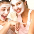 Caucasian girls wearing peeling mask having fun — Foto de Stock