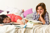 Caucasian girls studying at home — Stock Photo