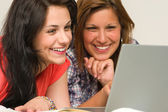 Joyful teens browsing on internet — Stock Photo
