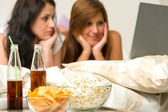 Young girls having slumber party, watching movies — Stock Photo