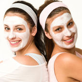 Happy caucasian girls wearing facial mask — Stock Photo
