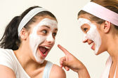 Two girls with cosmetic mask laughing — Stock Photo
