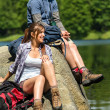 Young trekking couple resting at lakeside — Stock fotografie