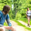 Male hiker looking back waiting the girl — Stock Photo #27295621