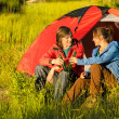 Camping teenagers drink beer outdoors — Stock Photo