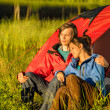 Camping couple enjoying sunset — Stock Photo