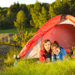 Young couple camping lying in tent — Stock Photo #27295775