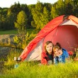 Young couple camping lying in tent  — Stock Photo