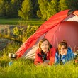 Young camping couple lying in tent — Stock Photo