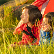 Young couple enjoying sunset from tent — Stock Photo #27295795
