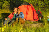 Camping couple sitting and enjoying sunset — Stock Photo