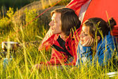 Young couple enjoying sunset from tent — Stock Photo