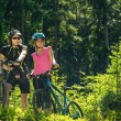 Stock Photo: Mountain bikers resting in forest