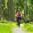 Cheerful biker couple in woods — Stock Photo