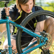 Male cyclist checking his bike — Stock Photo