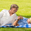 Elderly couple enjoying relax time in park — Stock Photo
