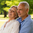 Senior couple embracing in nature — Stockfoto