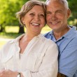 Stock Photo: Senior citizen couple laughing outdoors