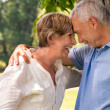 Stock Photo: Elderly couple laughing head to head