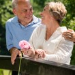 Romantic senior couple laughing outdoors — Stock Photo