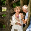 Senior couple romantic dating in park — Stok fotoğraf