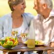 Senior couple enjoy lunch outdoor — Stock Photo