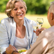 Senior couple celebrate outdoors happy retirement — Stock Photo