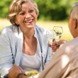 Senior couple celebrate outdoors happy retirement — Stock Photo #28858823
