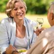Senior couple celebrate outdoors happy retirement — Stock Photo