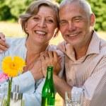 Cheerful senior couple smiling at camera — Stock Photo