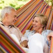 Happy elderly couple in hammock — Stock Photo