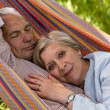 Senior Caucasian couple in hammock — Stock Photo