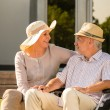 Senior disabled man and wife talking outdoors — Stock Photo