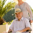 Senior wife with husband in wheelchair — Stock Photo